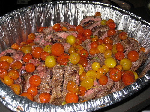 olive stuffed flank steak with tomato confit